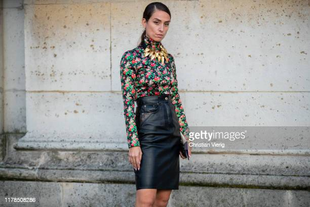 Erika Boldrin seen wearing blouse with floral print, high waist leather skirt, golden necklace outside Louis Vuitton during Paris Fashion Week...