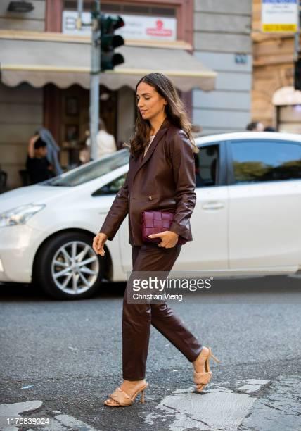 Erika Boldrin seen wearing brown leather blazer and pants bordeaux bag Bottega Veneta LIDO PS20 shoes outside the Vivetta show during Milan Fashion...