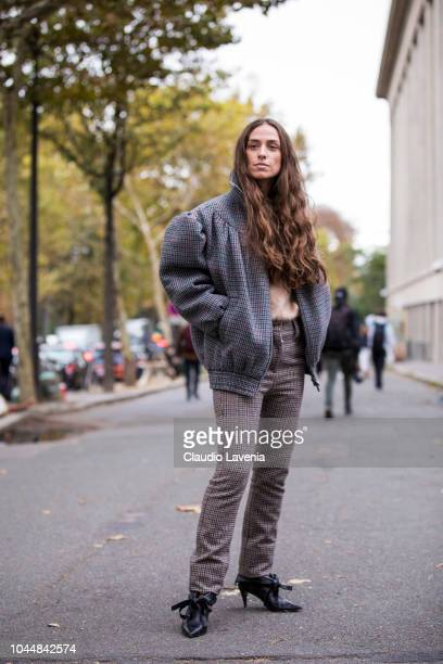 Erika Boldrin wearing a beige sweater brown checked trousers grey checked jacket and black heels is seen before the Miu Miu show on October 2 2018 in...