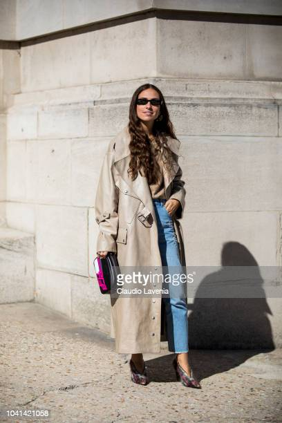Erika Boldrin wearing a beige trench coat blue jeans checked heels and a printed bag is seen after the Maison Margiela show on September 26 2018 in...