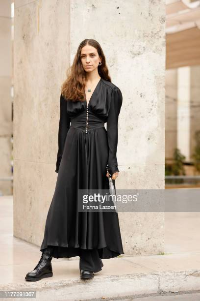 Erika Boldrin wearing a black silky maxi dress outside Paco Rabanne during Paris Fashion Week - Womenswear Spring Summer 2020 on September 26, 2019...