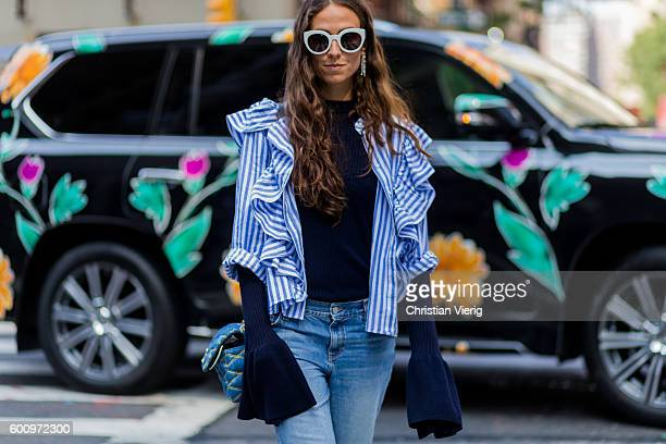 Erika Boldrin wearing a blue white stripped top Louis Vuitton bag and blue denim jeans outside Creatures of the Wind on September 8 2016 in New York...
