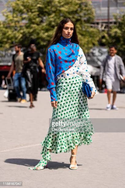 Erika Boldrin wearing a colorful printed top green and white printed skirt white heels and blue Kenzo bag is seen outside Kenzo fashion show on Day 6...