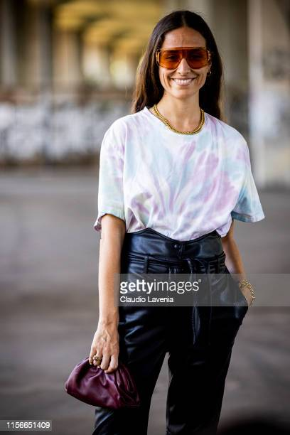 Erika Boldrin wearing a colorful tie dye tshirt black leather pants and burgundy Bottega Veneta bag is seen during the Milan Men's Fashion Week...