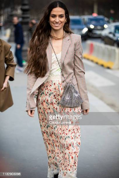 Erika Boldrin wearing a long printed dress black boots beige blazer and silver bag is seen outside Paco Rabanne on Day 4 Paris Fashion Week...
