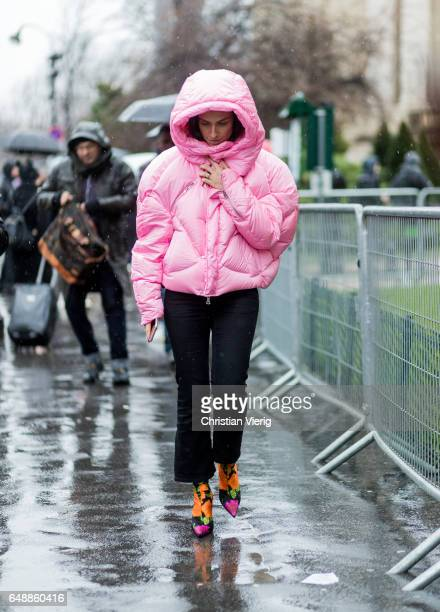 Erika Boldrin wearing a pink down feather jacket outside Sacai on March 6 2017 in Paris France