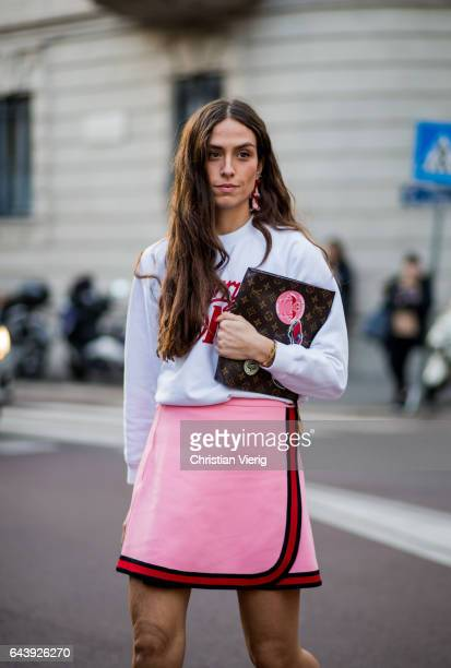 Erika Boldrin wearing a white sweater pink skirt Gucci shoes and socks outside Alberta Ferretti on February 22 2017 in Milan Italy