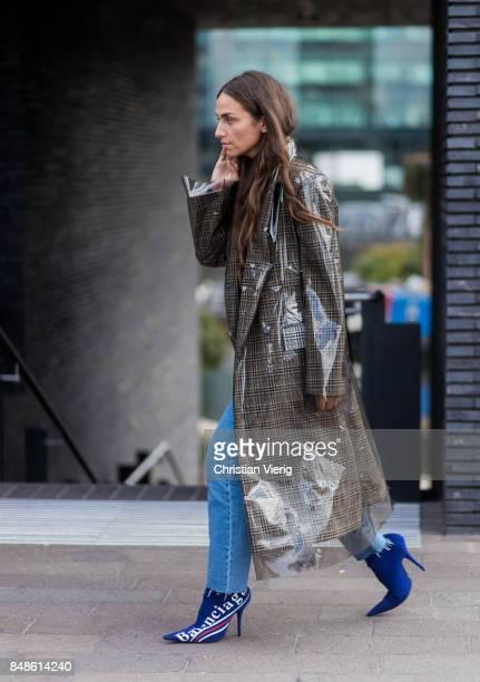 Erika Boldrin wearing Balenciaga boots Calvin Klein coat outside Versus Versace during London Fashion Week September 2017 on September 17 2017 in...