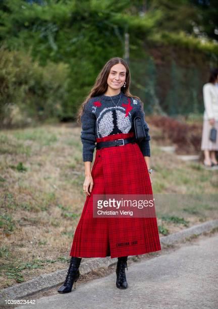 Erika Boldrin wearing belted high waist red skirt grey knit is seen outside Dior during Paris Fashion Week Womenswear Spring/Summer 2019 on September...