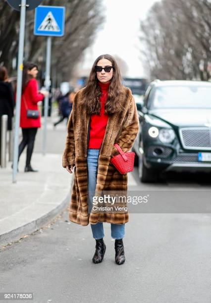 Erika Boldrin wearing brown fur coat red bag is seen outside Armani during Milan Fashion Week Fall/Winter 2018/19 on February 25 2018 in Milan Italy