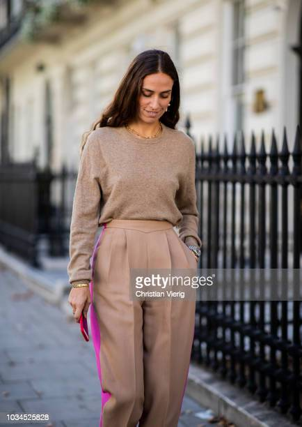 Erika Boldrin wearing brown pink two tone pants beige brown knit is seen outside Delpozo during London Fashion Week September 2018 on September 16...