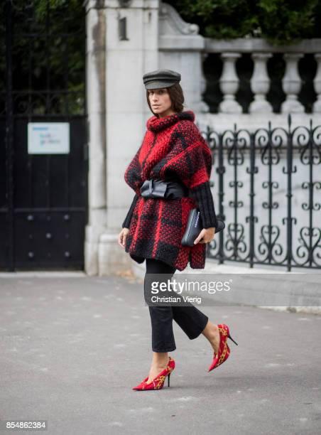 Erika Boldrin wearing flat cap checked jacket belt cropped denim jeans heels is seen outside Dries van Noten during Paris Fashion Week Spring/Summer...