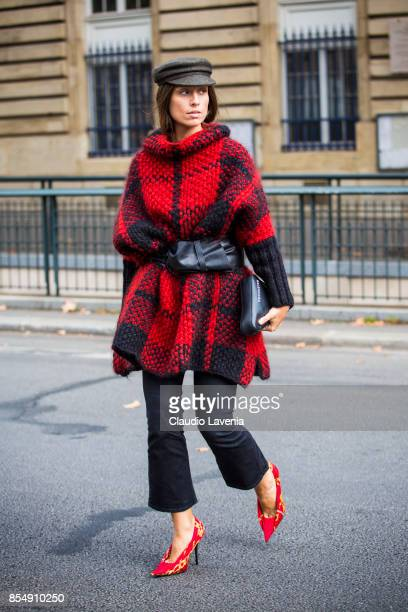 Erika Boldrin wearing flat cap red and black checked jacket belt cropped denim jeans and Balenciaga bag is seen before the Dries van Noten fashion...