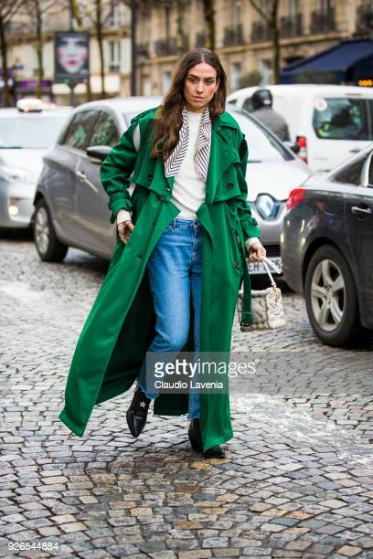 Erika Boldrin wearing green trench and white bag is seen in the streets of Paris after the Nina Ricci show during Paris Fashion Week Womenswear...