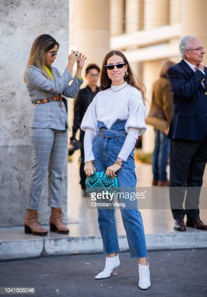 Erika Boldrin wearing high waist denim jeans white boots and knit is seen outside Dries van Noten during Paris Fashion Week Womenswear Spring/Summer...
