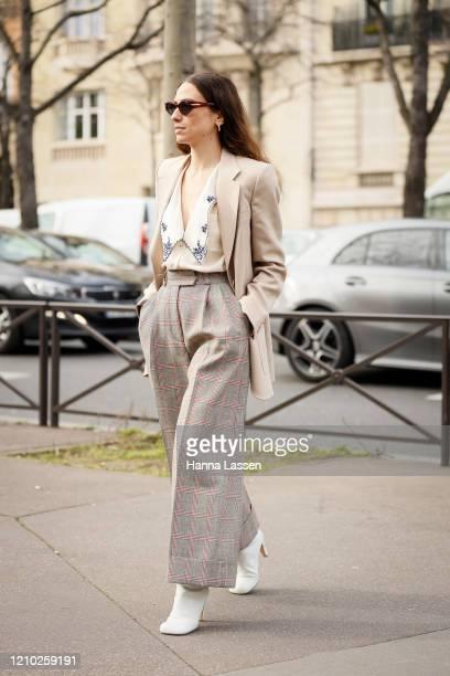 Erika Boldrin wearing Miu Miu jacket, plaid pants, white boots and embroidery shirt outside the Miu Miu show during Paris Fashion Week Womenswear...