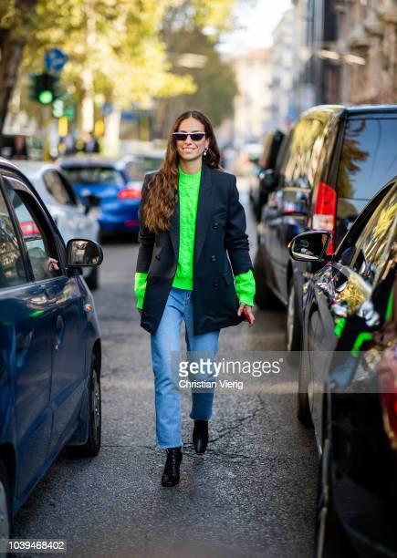 Erika Boldrin wearing neon sweater blazer denim jacket is seen outside Marni during Milan Fashion Week Spring/Summer 2019 on September 23 2018 in...