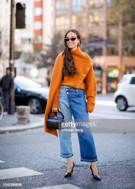Erika Boldrin wearing orange knit with long sleeves denim jeans is seen outside Koche during Paris Fashion Week Womenswear Spring/Summer 2019 on...