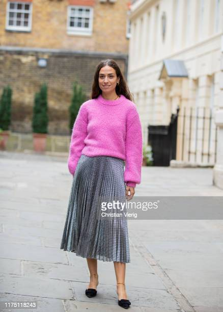 Erika Boldrin wearing pink knit silver pleated skirt seen outside Erdem during London Fashion Week September 2019 on September 16 2019 in London...