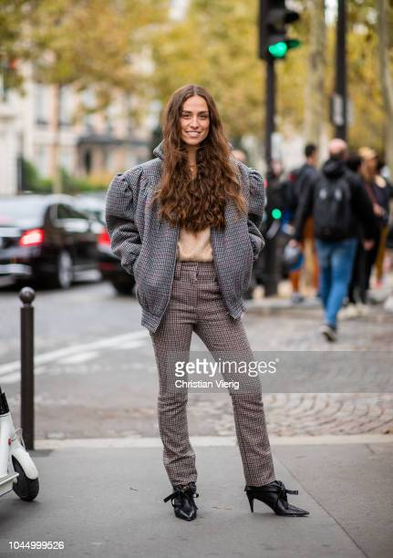 Erika Boldrin wearing plaid jacket pants knit is seen outside Miu Miu during Paris Fashion Week Womenswear Spring/Summer 2019 on October 2 2018 in...