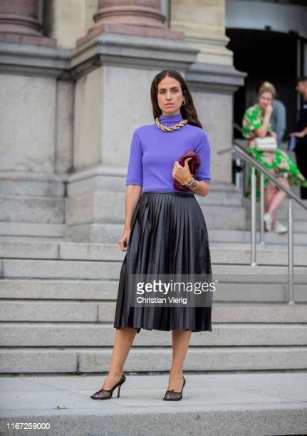 Erika Boldrin wearing purple turtleneck black pleated skirt is seen outside Samsøe Samsøe during Copenhagen Fashion Week Spring/Summer 2020 on August...