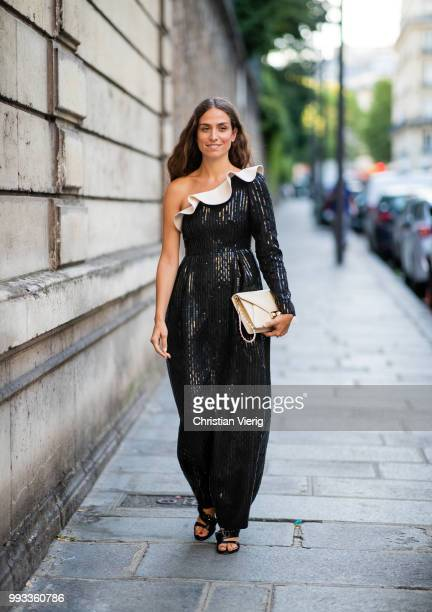 Erika Boldrin wearing ripped off shoulder dress seen outside Valentino on day four during Paris Fashion Week Haute Couture FW18 on July 4 2018 in...