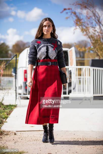 Erika Boldrin wearing sweater and a Dior red checked skirt is seen before the Christian Dior show on September 24 2018 in Paris France