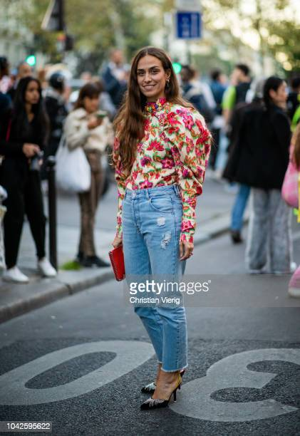 Erika Boldrin wearing top with floral print denim jeans is seen outside Off White during Paris Fashion Week Womenswear Spring/Summer 2019 on...