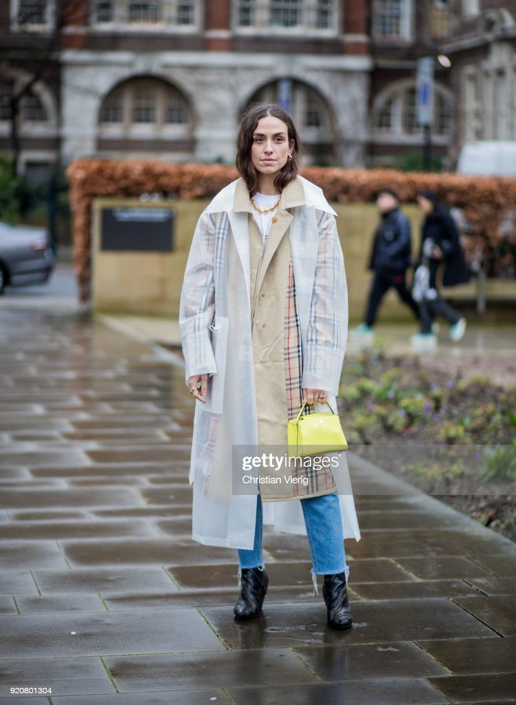 Erika Boldrin wearing transparent rain coat seen outside Christopher Kane during London Fashion Week February 2018 on February 19, 2018 in London, England.