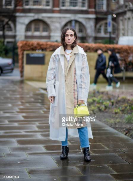 Erika Boldrin wearing transparent rain coat seen outside Christopher Kane during London Fashion Week February 2018 on February 19 2018 in London...