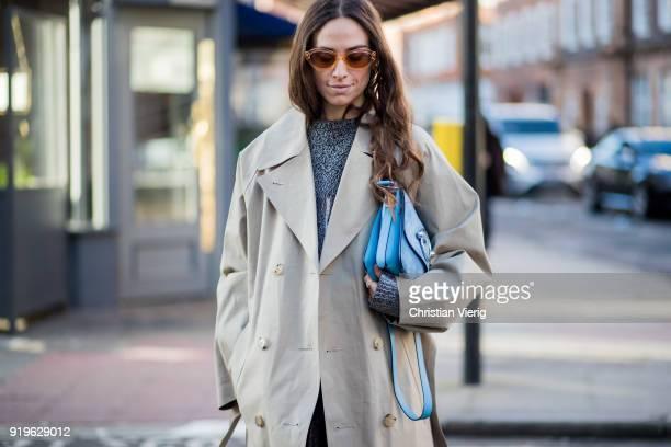Erika Boldrin wearing trench coat sheer heels seen outside JW Anderson during London Fashion Week February 2018 on February 17 2018 in London England