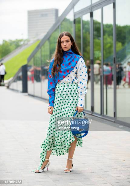 Erika Boldrin wearing two tone dress with dots prints blue bag is seen outside Kenzo during Paris Fashion Week Menswear Spring/Summer 2020 on June 23...