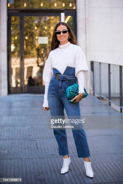 Erika Boldrin wearing white sweater high wasted jeans white boots and printed bag is seen before the Dries Van Noten show on September 26 2018 in...