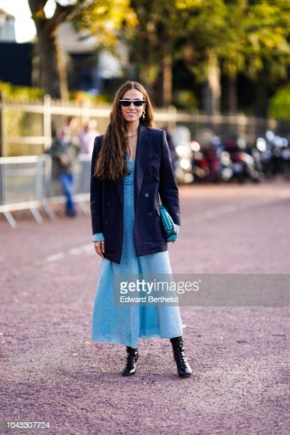 Erika Boldrin wears a black blazer jacket a blue dress a blue bag outside Hermes during Paris Fashion Week Womenswear Spring/Summer 2019 on September...