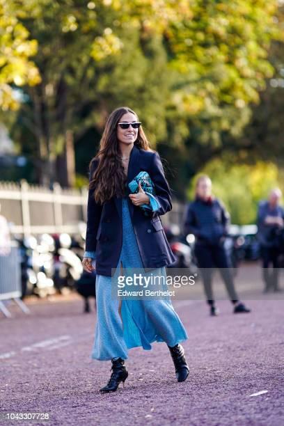 Erika Boldrin wears a black blazer jacket a blue dress a blue bag outside Hermes during Paris Fashion Week Womenswear Spring/Summer 2019 on September...