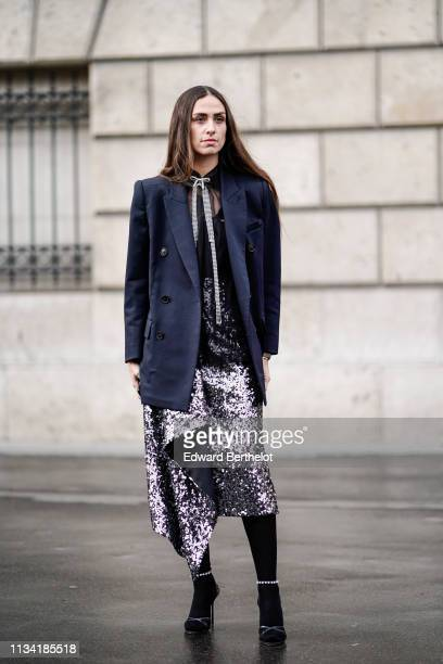 Erika Boldrin wears a blazer jacket a sequined skirt outside Miu Miu during Paris Fashion Week Womenswear Fall/Winter 2019/2020 on March 05 2019 in...