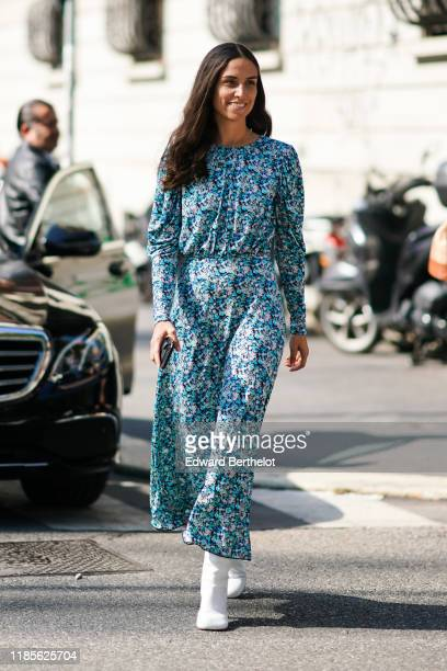 Erika Boldrin wears a blue floral print dress and white boots, outside the Marni show during Milan Fashion Week Spring/Summer 2020 on September 20,...
