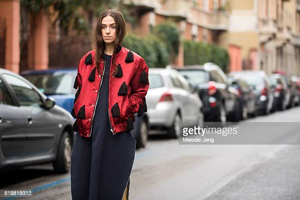 Erika Boldrin wears a red Au Jour Le Jour Prefall 2016 bomber jacket with black tassels and blue Ports 1961 dress at the Antonio Marras show during...