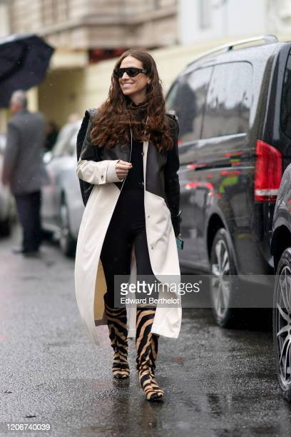 Erika Boldrin wears sunglasses a black and white leather long coat brown and black zebra print boots a black bag during London Fashion Week Fall...