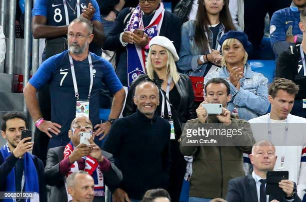 Erika Choperena wife of Antoine Griezmann of France between his parents Alain Griezmann and Isabelle Griezmann during the 2018 FIFA World Cup Russia...