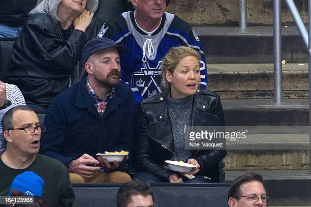 Erika Christensen and Cole Maness attend a hockey game between the Phoenix Coyotes and Los Angeles Kings at Staples Center on March 19 2013 in Los...
