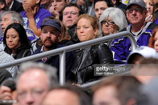 Erika Christensen and Cole Maness watche the game between the Los Angeles Kings and the Phoenix Coyotes at Staples Center on March 19 2013 in Los...