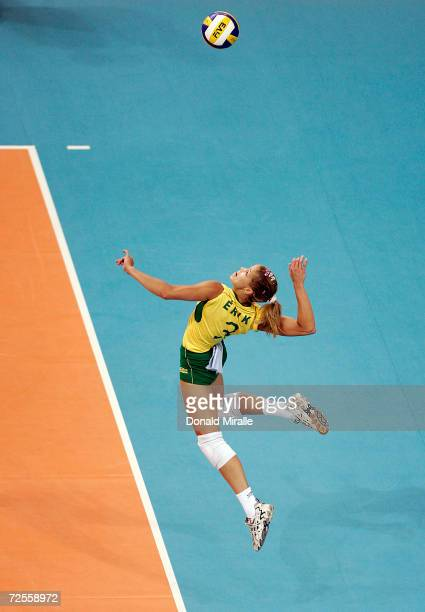 Erika Coimbra of Brazil serves during USA's 23 loss to Brazil in women's indoor Volleyball quarterfinal match on August 24 2004 during the Athens...