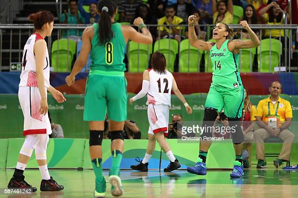 Erika Couza of Brazil celebrates after scoring against Japan during the women's basketball game on Day 3 of the Rio 2016 Olympic Games at the Youth...