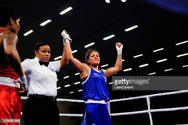 Erika Cruz of Mexico celebrates his victory against Adriana Araujo of Brazil during the Woman's Light Welter 5760 kg in the 2011 XVI Pan American...