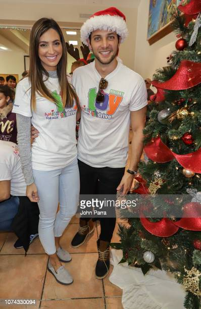 Erika Csiszer and Gabriel Coronel attend the Amigos For Kids 27th Annual Holiday Toy Drive on December 16 2018 in Miami Florida
