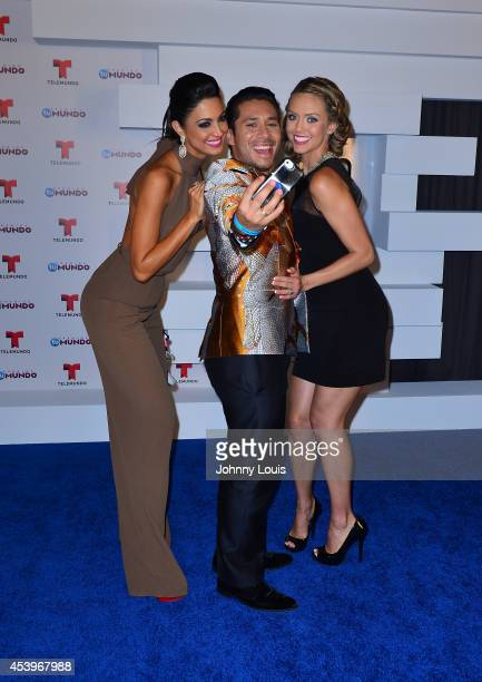 Erika Csiszer Christian Ramirez and Jessica Carrillo pose backstage at Telemundo's Premios Tu Mundo Awards 2014 at American Airlines Arena on August...