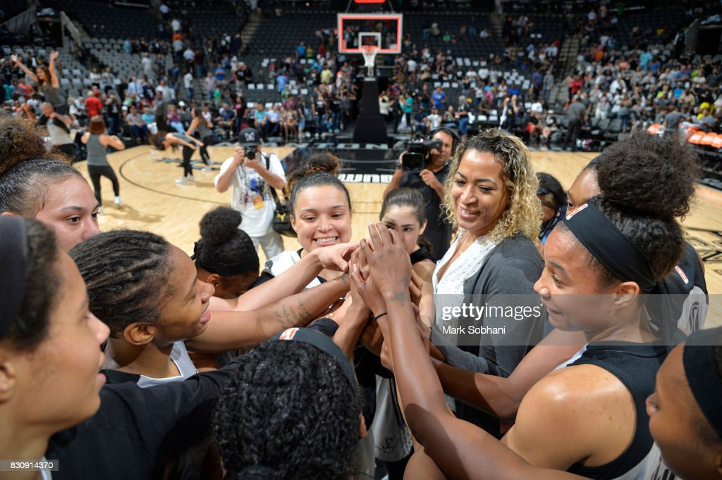 Erika de Souza #14 and Kayla McBride #21 of the San Antonio Stars with their teammates celebrate a win against the Atlanta Dream on August 12, 2017 at the AT&T Center in San Antonio, Texas.