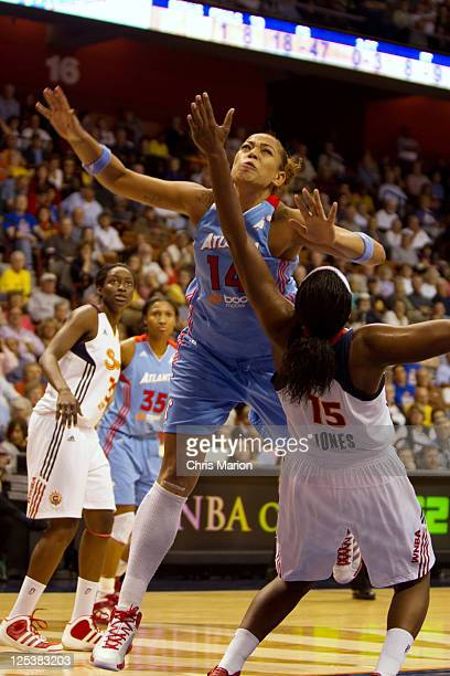 Erika de Souza of the Atlanta Dream and Asjha Jones of the Connecticut Sun collide in Game One of the Eastern Conference Semifinals during the 2011...