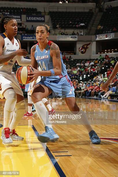 Erika de Souza of the Atlanta Dream dribbles to the basket against the Indiana Fever during their WNBA game on June 29 2014 at Bankers Life...